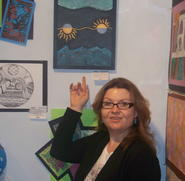 Principal, Tracey Staab, Showing off student art at Noyes